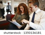 two diverse office colleagues... | Shutterstock . vector #1350136181