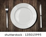 White Plate  Knife And Fork On...