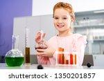 smiling schoolgirl holding... | Shutterstock . vector #1350201857
