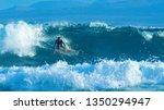 Big Barrel Wave Pushes The...