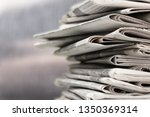 pile of newspapers on white... | Shutterstock . vector #1350369314