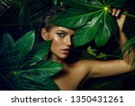 a beautiful tanned girl with... | Shutterstock . vector #1350431261