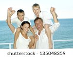 portrait of cheerful family in... | Shutterstock . vector #135048359