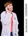 Female doctor talking on a cell phone - stock photo