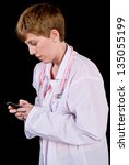 Female doctor texting on a cell phone - stock photo