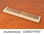 vintage wooden rake comb  on... | Shutterstock . vector #1350577937