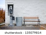 An Old Pay Phone Next To A...