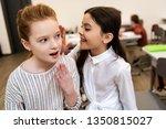 two cute schoolgirls smiling... | Shutterstock . vector #1350815027