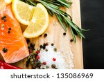 salmon fillet with  lemon | Shutterstock . vector #135086969