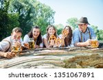 in beer garden in bavaria ... | Shutterstock . vector #1351067891