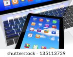 tablet pc with colorful apps on ...   Shutterstock . vector #135113729