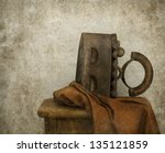 Still life with old fashion iron - stock photo