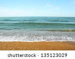 pebble beach and sea wave | Shutterstock . vector #135123029