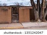 Weathered Wooden Door And Adob...