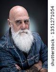 studio portrait of bald senior...   Shutterstock . vector #1351271054