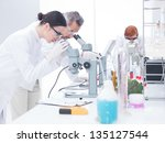 side view  of two scientists in ... | Shutterstock . vector #135127544