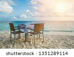 table outdoor next to sea... | Shutterstock . vector #1351289114