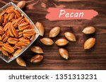 pecan nuts in the shell with... | Shutterstock . vector #1351313231