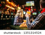 Stock photo fans watching match and drinks beer in sports bar 1351314524