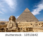 Sphinx and the Great pyramid in Egypt, Giza - stock photo
