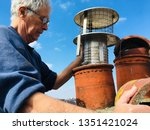 man working on roof with red... | Shutterstock . vector #1351421024