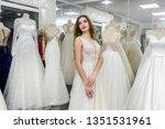 bride in wedding dress fitting... | Shutterstock . vector #1351531961