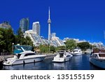 View of Toronto Waterfront with blue sky and Canada Tower as background - stock photo