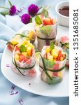 fresh fruits spring rolls for... | Shutterstock . vector #1351685081