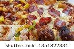 homemade pizza on wooden plate   | Shutterstock . vector #1351822331
