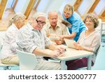 caregiver helps seniors in the... | Shutterstock . vector #1352000777