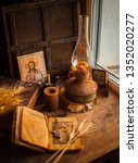 Small photo of Ukraine, Kyiv - February 24, 2019: religious still life. The church book is a prayer book. Kerosene lamp and church candles. Lampada Orthodox book for a Christian, a cross, an icon of Jesus Christ.