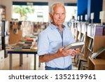 portrait of happy mature man... | Shutterstock . vector #1352119961