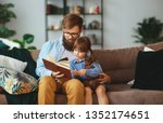 father reading a book to a... | Shutterstock . vector #1352174651