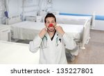 Doctor With A Clown Nose In Th...