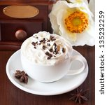 Cup of cappuccino with whipped cream and chocolate. - stock photo