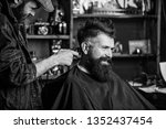 Barber with clipper trimming...