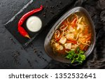 chicken soup with broth with... | Shutterstock . vector #1352532641