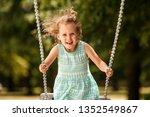 Happy Child Girl On Swing On...