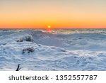 Winter Lake Sunset Landscape. Sunset horizon over a snowy Lake Michigan coast at Sleeping Bear Dunes National Lakeshore
