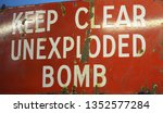 sign keep clear unexploded bomb  | Shutterstock . vector #1352577284