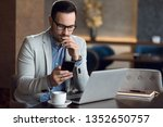 Young Businessman Reading A...