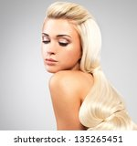 beautiful woman with long...   Shutterstock . vector #135265451