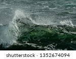 A Deep Emerald Green Wave With...