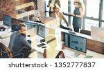 business colleagues talking... | Shutterstock . vector #1352777837