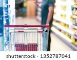 shopping cart with abstract... | Shutterstock . vector #1352787041
