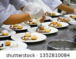 chef decorating many plates of...   Shutterstock . vector #1352810084