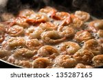 Closeup of fried shrimps in butter on a frying pan - stock photo