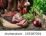 Fresh piece of ham in a homemade smokehouse - stock photo