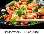 Closeu of tasting fried shrimp with chopsticks - stock photo