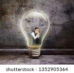 business man thinking inside a... | Shutterstock . vector #1352905364